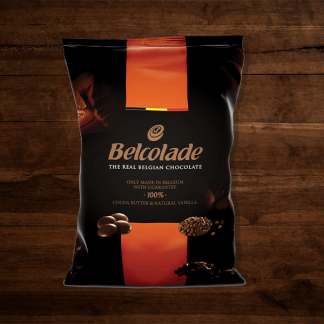 The Red Vintage South Africa Belcolade Belgian Chocolate Milk Chocolate Package with Orange Details on Dark Wood Back Ground