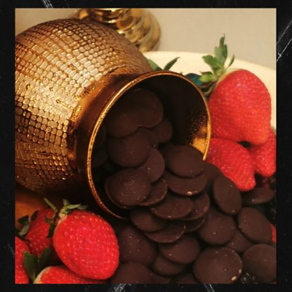 The Red Vintage Belcolade Belgian Chocolate in a Gold vase between strawberries