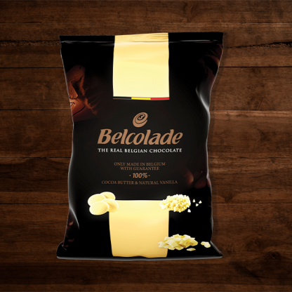 The Red Vintage South Africa Belcolade Belgian Chocolate Milk Chocolate Package with Creamy Yellow Details on Dark Wood Back Ground